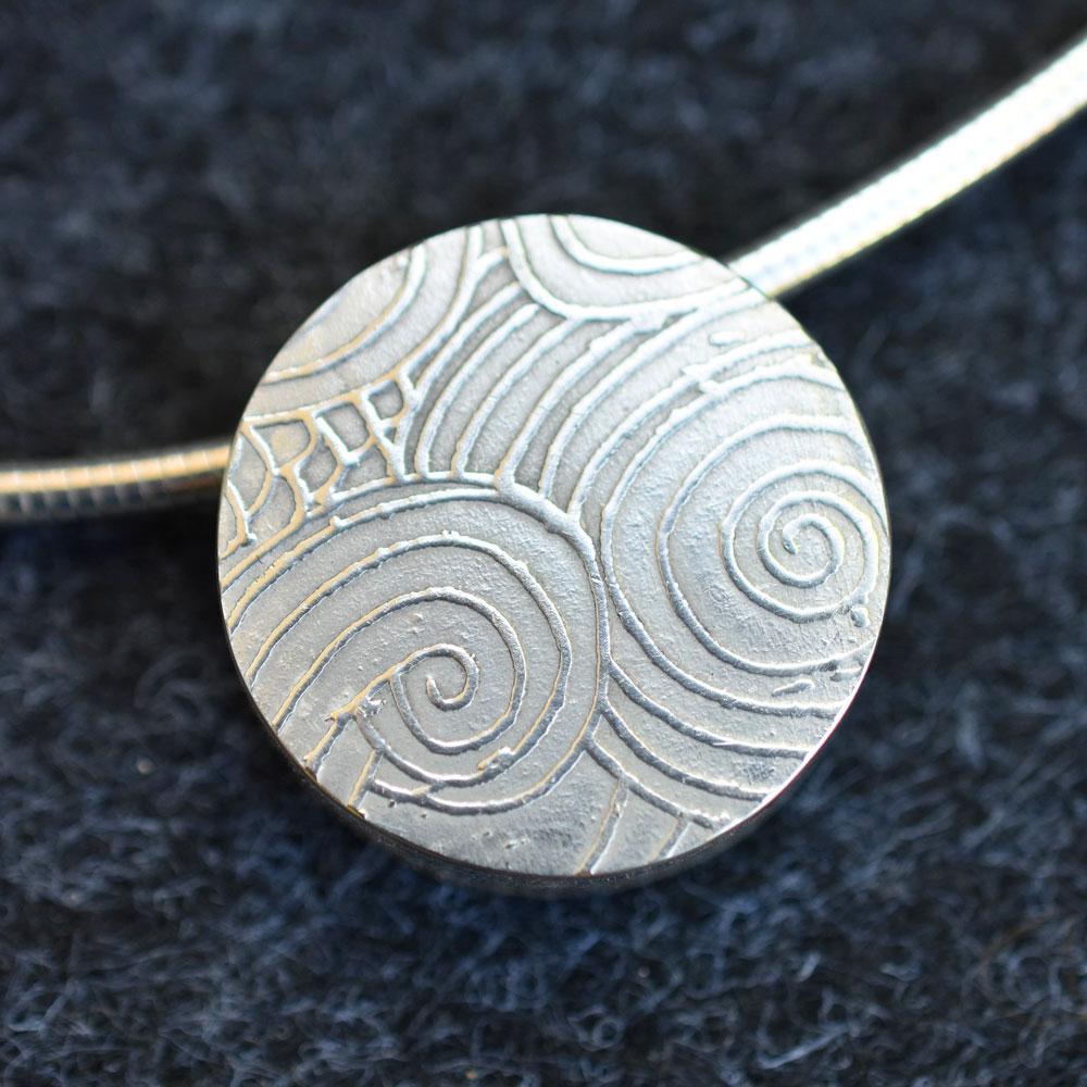Anne Lindsay - round swirl pattern pendant